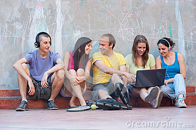 Five young people having fun outdoors