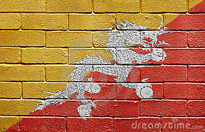 Flag of Bhutan on brick wall