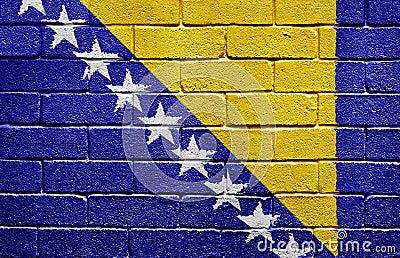 Flag of Bosnia and Herzegovina on brick wall