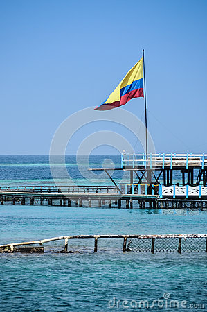 Flag of Colombia over the turqoise Ocean. Cartagena de Indias, South America.