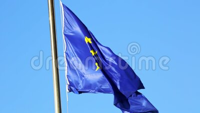 Flag of Europe. Blue color with yellow stars waving in the wind on blue sky in slow motion. The concept of European union and community unity stock footage