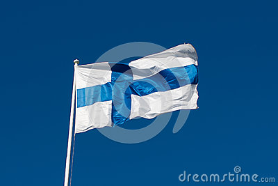 Flag of Finland before blue sky.