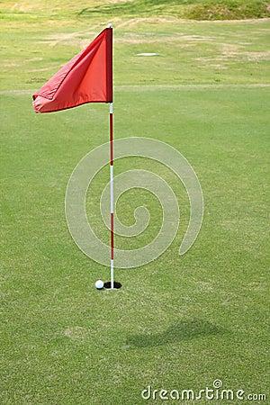 Flag on golf course.