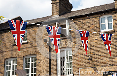 Flag of Great Britain with house in background
