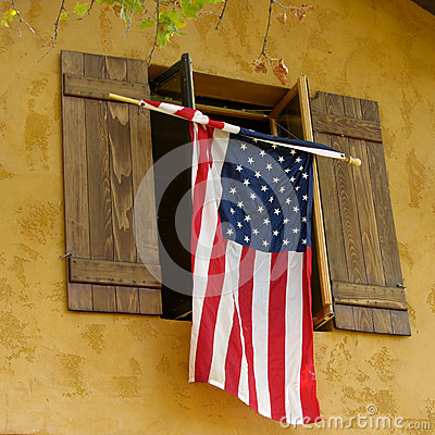 Flag hanging from shutters