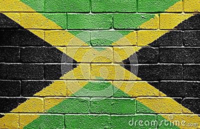 Flag of Jamaica on brick wall