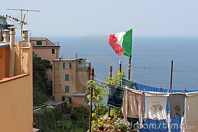 Flag upon laundry hung on to dry, Corniglia.