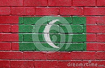 Flag of Maldives on brick wall