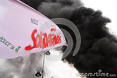 Flag and smoke Editorial Photography