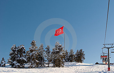Flag of Turkey on mountain peak in Sarikamis
