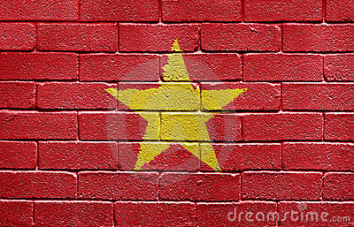 Flag of Vietnam on brick wall