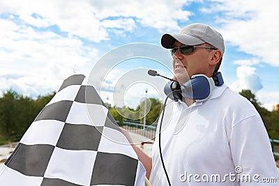 Flagman with checkered flag