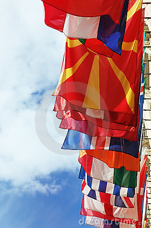 Flags of Europe states against cloudy sky