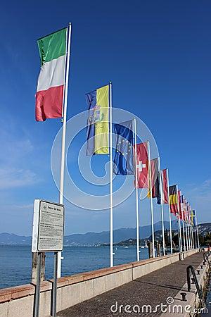 Flags flying, harbor, Bardolino, Lake Garda, Italy Editorial Stock Image