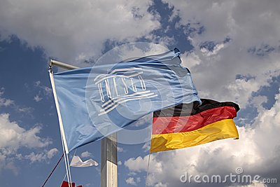 Flags of Germany and UNESCO Editorial Stock Photo
