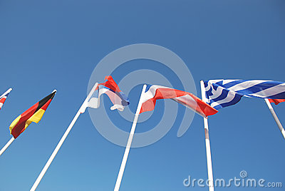 Flags set of masts on a background of blue sky