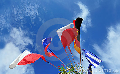 Flags of several Europe states against cloudy sky