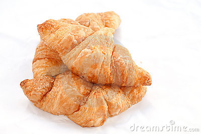Flaky croissants on white background.