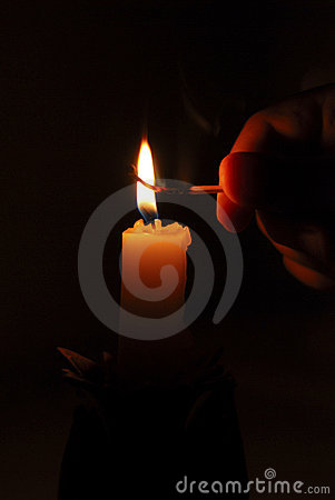 Flame of candle, matchstick and finger in the dark