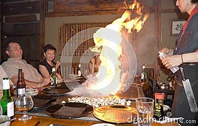 Flame:Japanese teppanyaki restaurant scene.