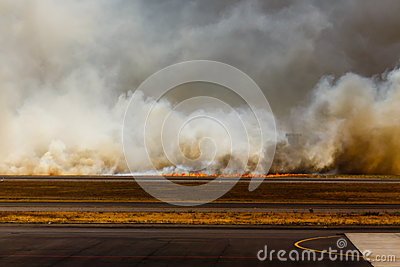 Flames from Airport Brush Fire in El Salvadore, Central America