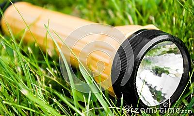 Flashlight in grass