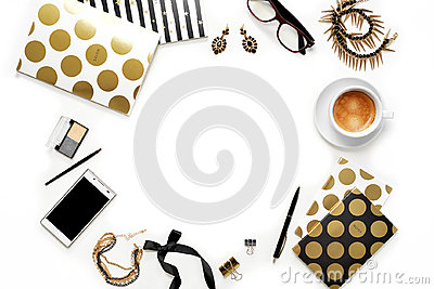 Flat lay fashion feminine home office workspace with phone, cup of coffee, stylish black gold notebooks, cosmetics and jewelry on Stock Photo