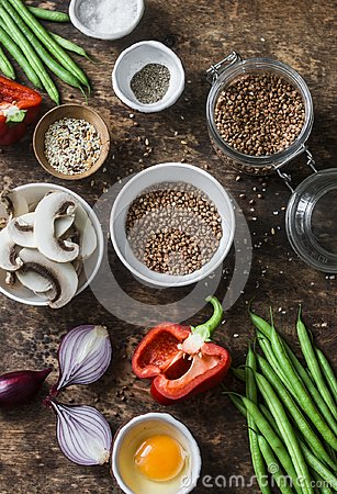 Free Flat Lay Healthy Vegetarian Food Ingredients For Lunch On A Wooden Background, Top View. Buckwheat, Green Beans, Sweet Peppers, Re Stock Photos - 108635683
