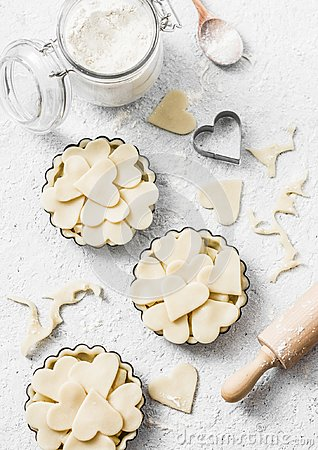 Free Flat Lay Valentine`s Day Baking Background. Raw Apple Tartlets In The Baking Dish And Baking Ingredients On Light Background Stock Images - 108353874