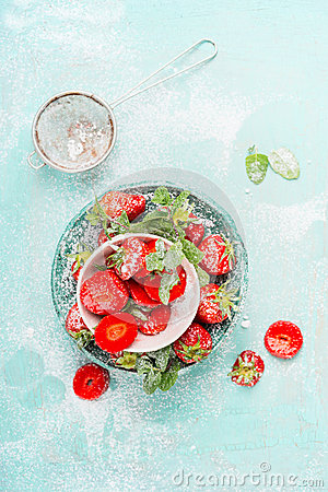Free Flat Lay With Sweet Sliced  Strawberries In Bowls With Icing Sugar On Light Blue Background Stock Photo - 72061900