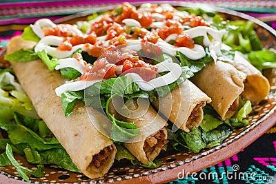 Flautas de pollo tacos and Salsa Homemade food Mexican mexico city Stock Photo