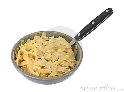 Flavored pasta noodles in bowl with fork