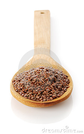 Flax-seed in wooden spoon