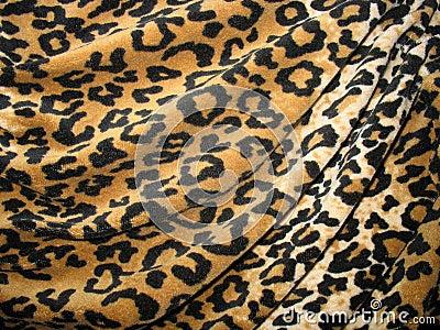 Fleecy brown draped leopard skin fabric