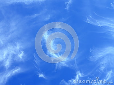 Fleecy clouds in blue sky