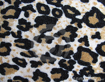 Fleecy white and brown leopard skin fabric