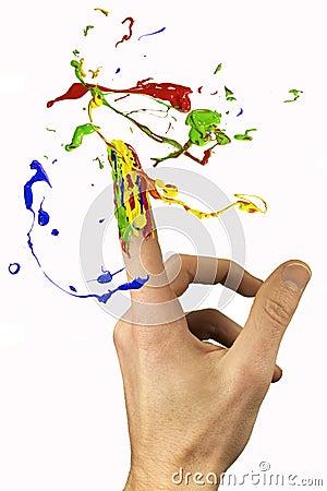 Flerfärgad målarfärg som cirkulerar runt om pekfingret