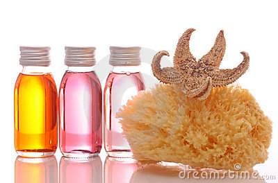 Flessen met essentiële oliën en spons