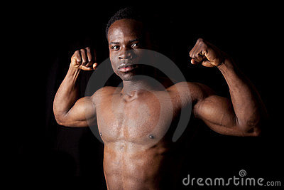 Flex muscles on black