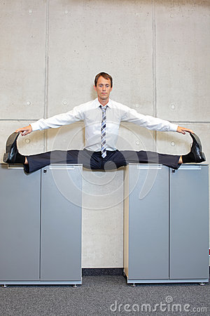 Free Flexible Business Man In The Center,  Split Position On Cabinets. Royalty Free Stock Photo - 50173585
