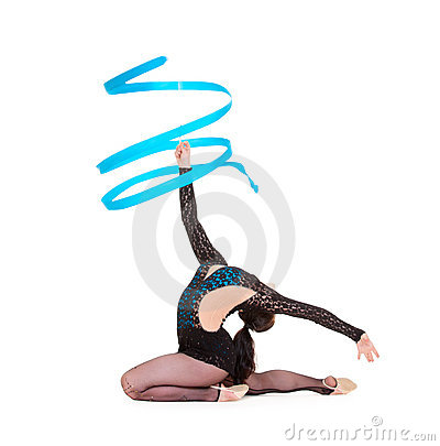 Flexible gymnast dancing with blue ribbon
