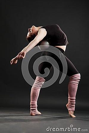 Flexible sportswoman with ball