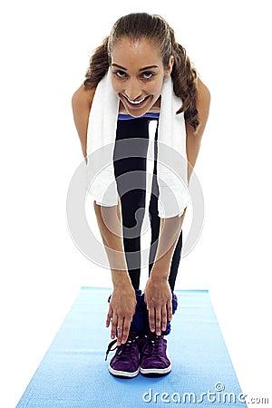 Flexible woman bending down till toes