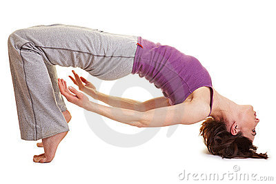 Flexible woman doing a bridge