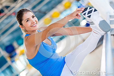Flexible woman at the gym