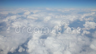 Flight above clouds. Blue sky view from flight above clouds. Video clip filmed from plane stock video footage
