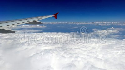Flight above the clouds. Scenic flight above the clouds with blue sky and airplane wing stock video