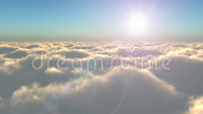 Flight above the clouds. Scenic flight above the clouds towards the sun