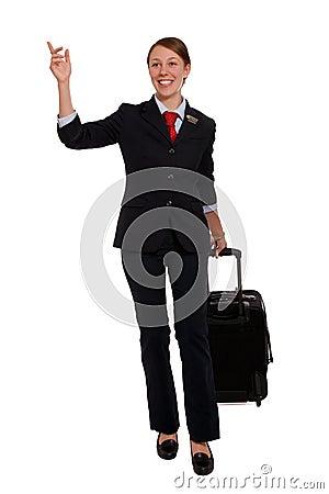 Flight attendant hailing a taxi