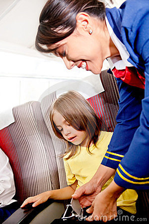 Flight attendant helping a kid